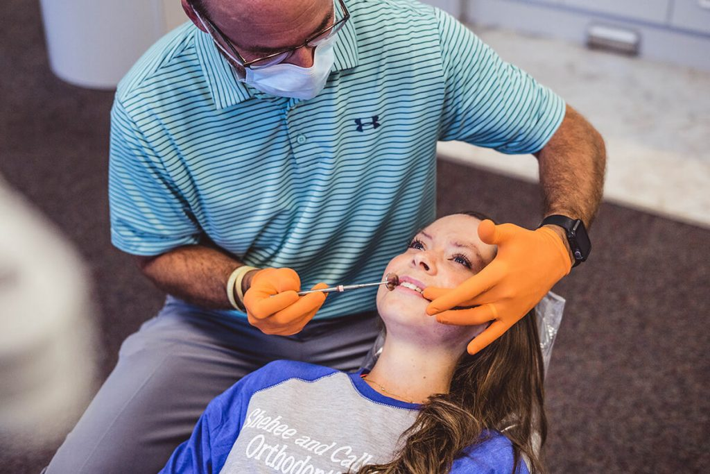 orthodontist-doctor-chad-callahan-performs-braces-exam-on-female-patient-in-milton-florida-office